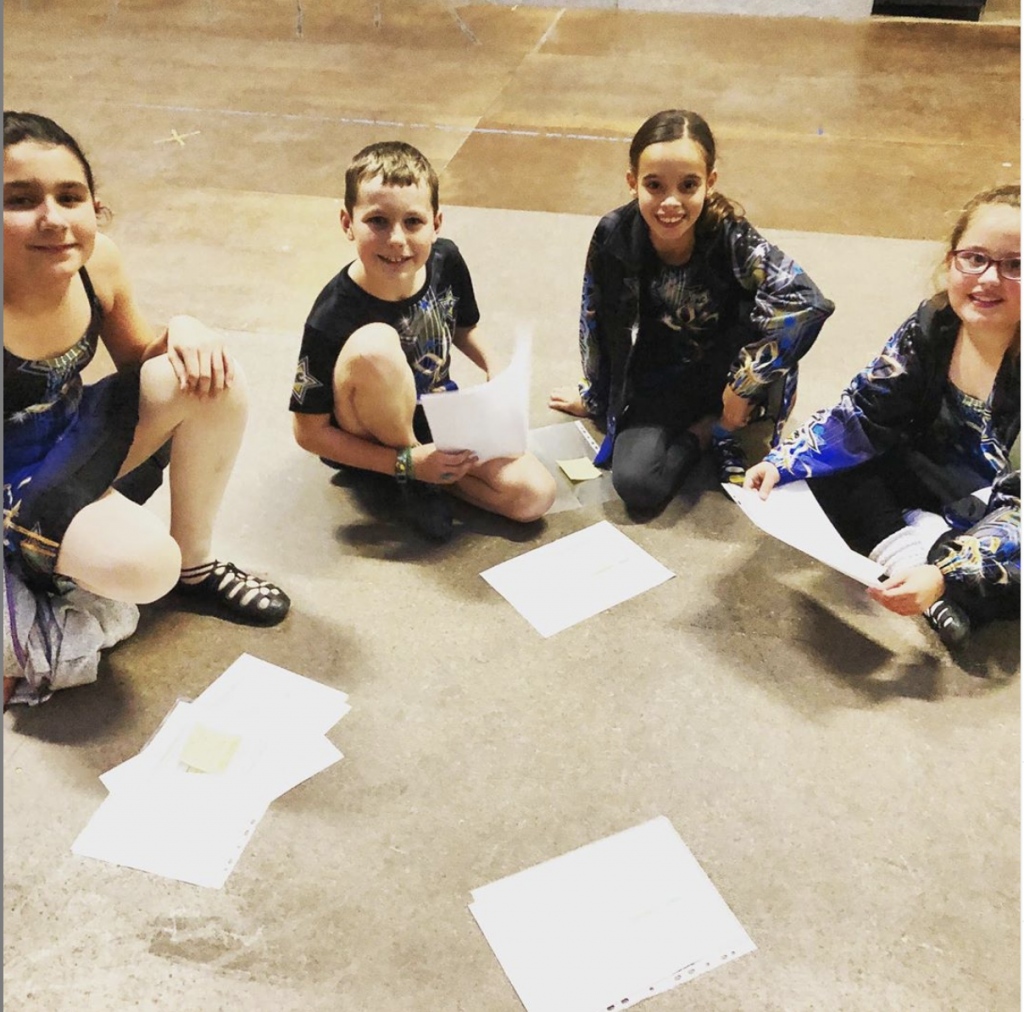 Artz Collective dancers smiling, going through their Digital Feis scoresheets